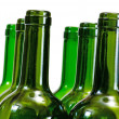 Wine bottles close-up isolated over white background - Stock Photo