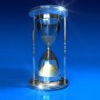 Hourglass on blue — Stock Photo