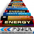 Row of different AA batteries - Stock Photo