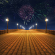 Night fireworks on the empty bridge — Stock Photo