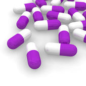 Violet pills — Stock Photo