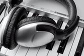 Headphones on synthesizer keyboard — Stock Photo