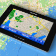 Stock Photo: GPS navigator on map