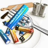 Eating batteries — Stock Photo