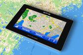 GPS navigator on map — Stock Photo