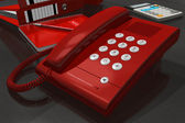 Red phone on office table — Stock Photo