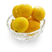 Lemons in crystal bowl — Stock Photo