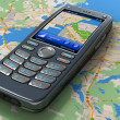 Mobile phone with GPS navigation on map — Stock Photo #4273941