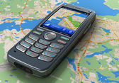 Mobile phone with GPS navigation on map — Stock Photo