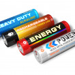 Set of four different AA batteries - Stock Photo