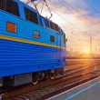 Stock Photo: Sunset at railway station