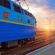 Stock Photo: Sunset at the railway station