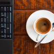 Laptop and coffee — Stock Photo