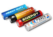 Set of four different AA batteries — Stock Photo