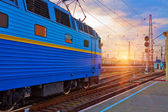 Sunset at the railway station — Stock Photo