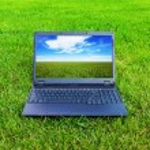 Laptop on grass — Stock Photo #4319410
