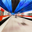 Passenger train passing railway station — Stock Photo