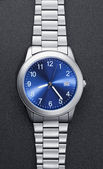 Stainless steel watch on black — Stock Photo