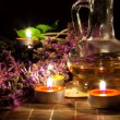 Tea candles, oil and lavender — Stock Photo