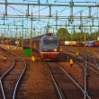 Stockfoto: Freight train passing railway station