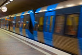 Metro station with motion blur effect — Stock Photo