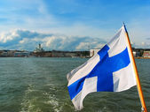 Panorama of Helsinki with Finnish flag — Stock Photo