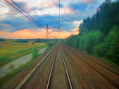 Scenic railroad sunset with motion blur — Stock Photo