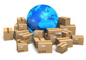 Cardboard boxes and Earth globe — Stock Photo