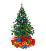 Decorated Christmas tree with gifts — Stock Photo