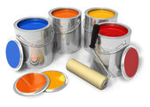 Cans with color paint and roller brush — Stock Photo