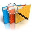 File search concept: folders and magnifying glass — Stock Photo