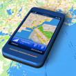Smartphone with GPS navigator on map — Stock Photo