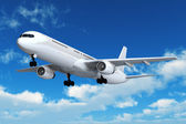 Passenger airliner flight in the blue sky — Stock Photo