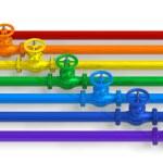 Rainbow pipelines with valves — Stock Photo