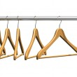 Coat hangers on clothes rail — Stock Photo