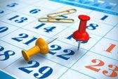 Pushpins and calendar — Stock Photo