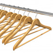 Coat hangers on clothes rail — Stock Photo #5077203