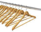 Coat hangers on clothes rail — Stock Photo