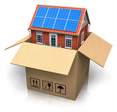 House with solar batteries in cardboard box — Stock Photo