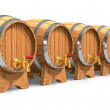 Row of wooden wine barrels with valves — Stock Photo