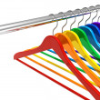 Rainbow hangers on clothes rail — Stock Photo