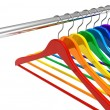 Stock Photo: Rainbow hangers on clothes rail