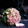 Stock Photo: Wedding bouquet of pink roses with rings