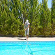 Stock Photo: Swimming pool cleaner