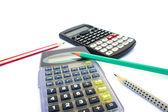 Calculators and pencils — Stock Photo