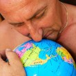 Royalty-Free Stock Photo: Man hugging the globe