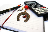 Calculator, pen and notebook — Stock Photo
