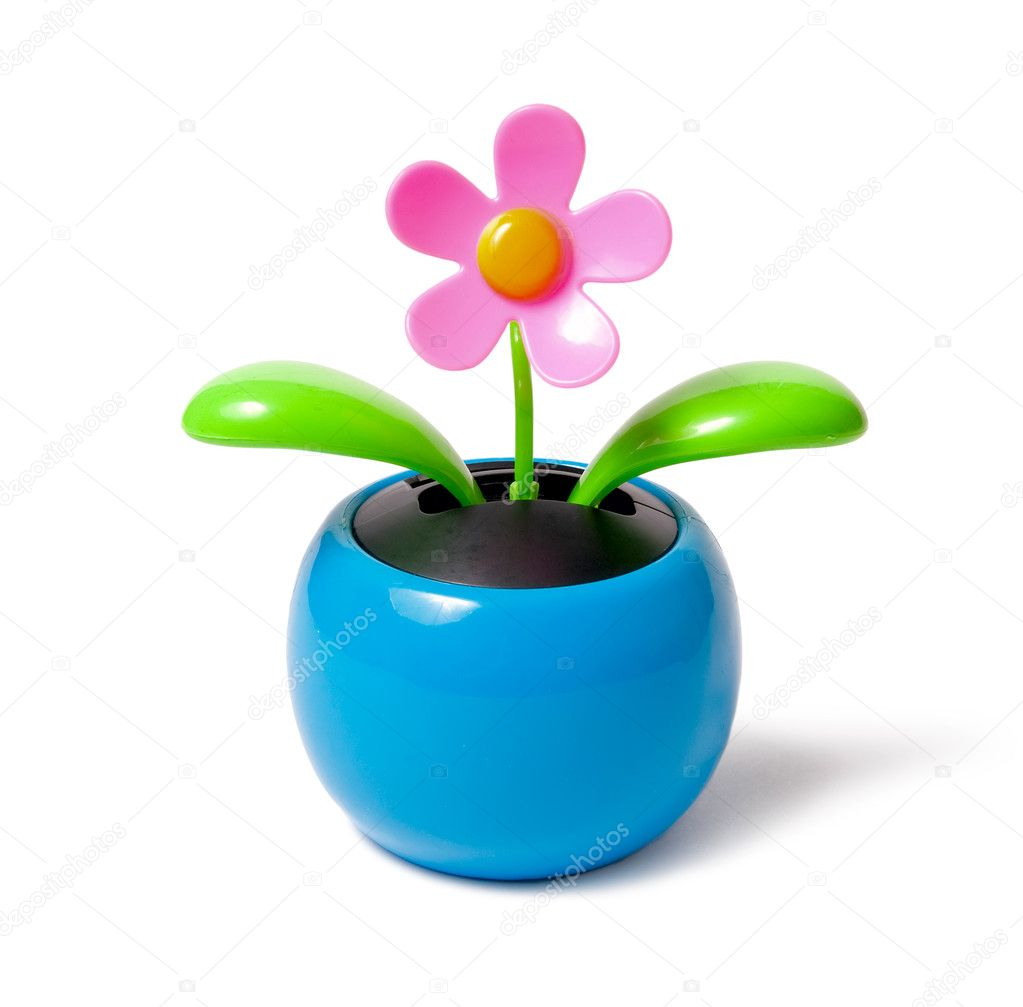 Flower on the solar battery — Stock Photo #5249159