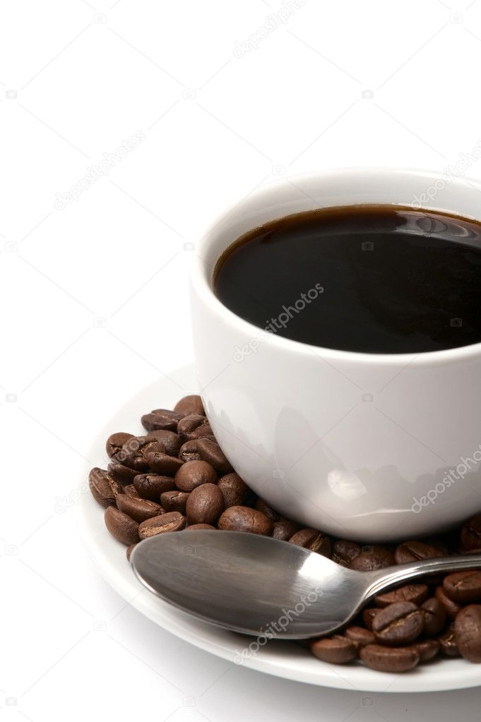 A full cup of black coffee with some coffee beans.  Stock Photo #5249241