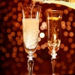 Champagne pouring into elegant glass - Stock Photo